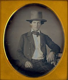 daguerreotype of a man with a tall hat.