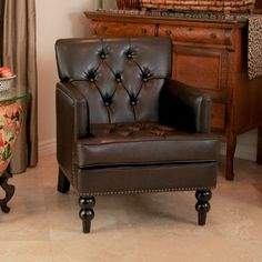 The Murphy Club Chair features studs, tufting and even carved wood legs that denote only the finest club chair elegance.