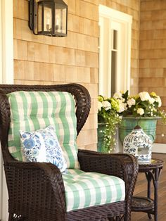 Wicker chair on front porch - love that big cushion on the back. -- #countryliving and #dreamporch