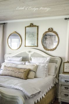I love the old style mirrors above the headboard~