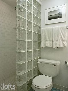 Subway Tile with glass block | full bathroom ensuite features a glass block shower stall.
