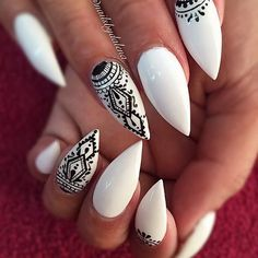 Black & White Patterned Stiletto Nail Design.