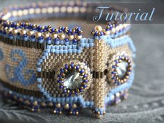 This very special bracelet is completely beadwoven, with a seperate clasp that has buttonholes to fit around the Rivoli bezels at the ends of the strap to close it up. It has a swirly peyote pattern at the strap, thats why its called Serpentine, nice ruffled embellishments at the sides and the clasp as a real eyecatcher!  Also this bracelet is perfect for people with a metal allergy, since there are no metal parts at all in this piece.  These instructions are written in English.  The PDF…