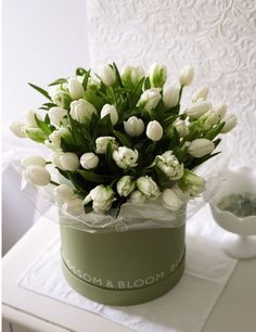 White standard and parrot tulips in a hat box