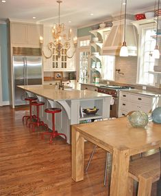 sea glass w/ touches of red for my coca-cola collection, pot filler spout on the stove, subway tile, wood table & open shelving..pretty close to my dream kitchen!