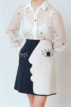 Navy canvas and pink cotton sateen skirt with hand-embroidered eyes and eyelashes. Skirt runs small. Please do not hesitate to reach out with any size questions. 100% Cotton Made in India