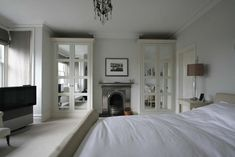 Mirrored wardrobes either side of fireplace