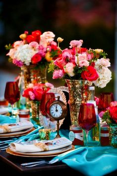 Centerpieces with white hydrangeas, baby pink roses, and accent red orange?
