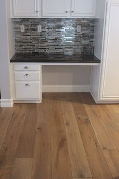 Built in desk in kitchen with the matching back splash. Hallmark Floors Alta Vista Collection: Del Mar. Engineered Hardwood Flooring by Hallmark Floors