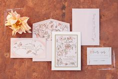 This collection's antique-pink floral motif is repeated on the invitation, reception card envelope and envelope liner.