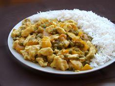 Petto di pollo al curry con peperoni e piselli