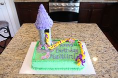 Easy to do - Rapunzel cake. Covered a pringles can with fondant as the tower and braided yellow fondant with ribbon for her hair. Made basic 9x13 cakes (2) and homemade buttercream frosting.