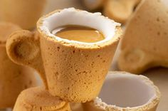 The edible cookie cup is made of a light (but sturdy) pastry and lined with sugar to make it waterproof. The sugar dissolves slightly to sweeten the coffee as you drink it