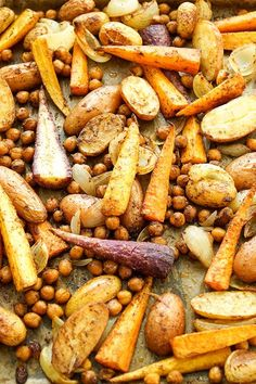 Moroccan Oven Vegetables with Chickpeas Recipe Elle Republic - A simple recipe for Moroccan oven-roasted vegetables with roasted carrots and potatoes. High Protein Vegetarian Recipes, Chickpea Recipes, Vegetarian Recipes Dinner, Healthy Vegetable Recipes, Herb Recipes, Oven Vegetables, Roasted Vegetables, Carrots And Potatoes, Roasted Carrots