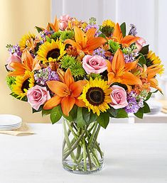 Send a vibrant bouquet of bright flowers like hot pink roses, orange lilies, and yellow sunflowers with our Florist Delivered Floral Embrace bouquet from Deliver sentiments of a warm embrace and brighten their day with this beautiful arrangement. Easter Flower Arrangements, Easter Flowers, Beautiful Flower Arrangements, Fall Flowers, Summer Flowers, Fresh Flowers, Floral Arrangements, Beautiful Flowers, Succulents