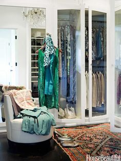 Use glass-fronted doors on your closets to make dressing a breeze. Designed by Betsy Burnham. housebeautiful.com #bedroom #bohemian_closet #closet #turkish_carpet #decorating_ideas