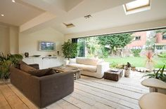 Huge entertainment/family area with concertina doors to garden Concertina Doors, Cosy Apartment, Renting A House, Beautiful Homes, Outdoor Furniture Sets, Sweet Home, New Homes, Cottage, House Design