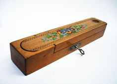This traditional wooden pencil box is known as a plumier in France.    This is a wonderful example of a mid-century plumier with its own lock and