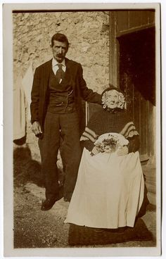 Victorian Era Post-Mortem Photography: Woman with her dead child-with her eyes painted on. Description from pinterest.com. I searched for…