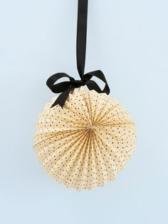 black and cream dotted paper lantern... buy it here.