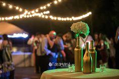 Wine bottles painted gold for wedding table decorations. Dunleith Plantation Wedding, Natchez, MS