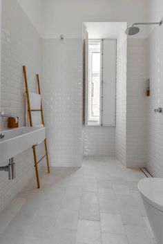 All-white tiled bathroom.