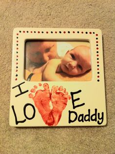 Picture frame I painted for Brad using Levi's footprints.