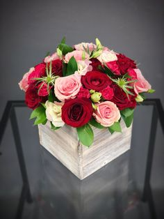 Large wood box arrangement for a table with red and soft pink roses and eustomas