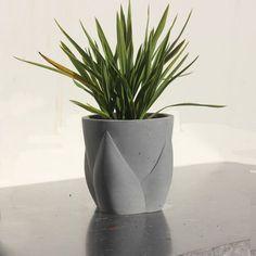Flowerbud concrete planter