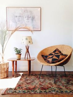 Little sitting area with a round chair and side table.