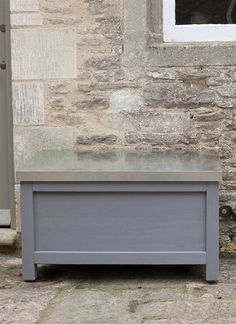 A painted storage box in Charcoal with a zinc lid