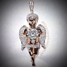 GOLDEN SUN JEWELRY: Our newest diamond Cherub. 14kt. Rose Gold with Russian Cut diamonds. This Cherub features a 4.00ct. Round Brilliant cut in his hands. #cherub #angel #diamonds #diamondpendant #pendant #roundbrilliant #rosegold #gold #flawless #fashion #fashionista #designer #gia #certified #kilogang #customking #bespoke #couture #jewelry #bling #luxury #russiancut