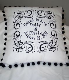Use a swirl or damask design in the corners with names in the center.