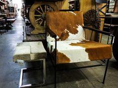 Cowhide club chair and ottoman stool. #natural #cowhide #chair #clubchair #ottoman #stool #steel #chrome #haironhide #cowhide #imports #wholesale #furniture #interiordesigner #interiordesigners #Phoenix #Tempe #Scottsdale #Arizona #AZ #home #decor #homedecor #design #southwest #warehouse #hide #hair #luxury