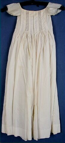 Dress, baby's, off-white cotton, vertically pintucked fitted bodice with pleat-fitted skirt, 1865-1870