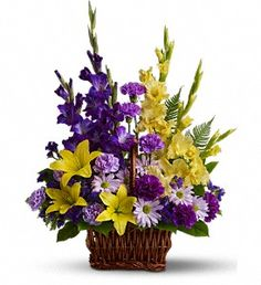 T218-3A Basket of Memories Bouquets, Traditional flower design created with gladioli, tiger lilies and carnations - Timmins Flower Shop