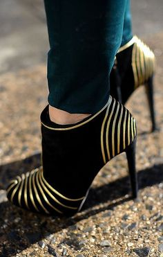 Cute booties with gold detailing. These look like they would kill your feet but they're lovely for a special occasion.