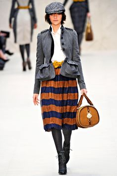 Burberry Prorsum Fall 2012 women's collection: interesting combination of patterns and colors, but design seems determined to highlight the hips. :(