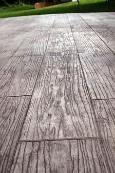 wow, i'm obsessing over this idea - stamped concrete to look like wood or stone. definitely an option for a patio. Love this idea; great for basement, could stain dark brown for better wood effect! by Helen Mata