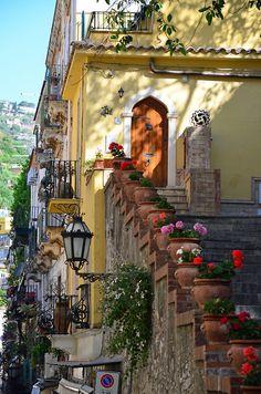 Stairway, to a beautiful door, in Taormina, Italy