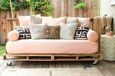 use pallets and piping to make a couch for the patio .