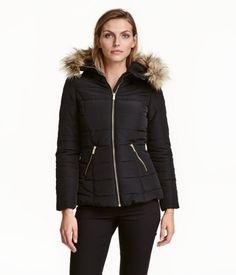 Black. Padded, fitted jacket with a high collar and a hood with faux fur trim. Zip at front, side pockets with zip, and concealed elastication at cuffs and