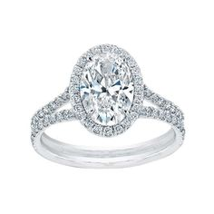 Norman Silverman Oval Diamond & Split Shank Pave Engagement Ring. Don't normally like oval cut rings but LOVE this!