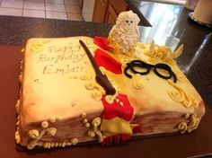 Harry potter birthday cake. Handmade hedwig, glasses, wand, and snitch. All edible.