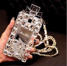 Galaxy S4, S5, Note 2, Note 3 - Glittering Perfume Purse With Strap Case in Assorted Colors & Models   Item 1322  Features:  - Brand: Samsung Galaxy S5, S4, Note 2, Note 3 Type: Rhinestone Case Purse Case Function: Protective, Decorative Material: TPU Colors: Clear, Black Theme: Bli