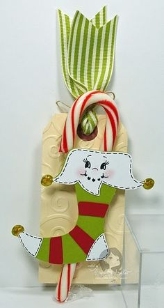 Christmas decorations:  scrapbook paper, ribbon, painted wood cutout, candy cane