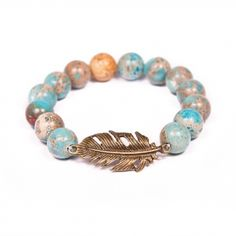 LIBERTY BRACELET: The freedom is hidden in this bracelet. Therefore, if you're an independent person, a wanderer and free as a bird let it know with the bracelet made of a feather charm and boho beads reminding sea water mixed with sand.
