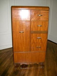 Hello AT,  I recently bought an art deco bureau dresser from a woman here in New York.  I don't know anything about the piece other than she told me it had been appraised for $1000.  However, there is quite a bit of damage to the surface of the piece - scratches, nicks, some discoloration in parts, and one of the shell-shaped handles on the drawers is missing.   Does anyone know if a) There's a way to repair or diminish the surface damage myself?...