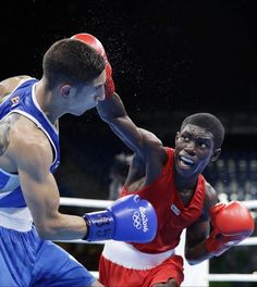 Colombia's Yurberjen Herney Martinez, right, fights Spain's Samuel Carmona Heredia during a men's light flyweight 49-kg quarterfinals boxing match at the 2016 Summer Olympics in Rio de Janeiro, Brazil, Wednesday, Aug. 10, 2016.