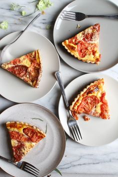 Pumpkin spice lattes are back at Starbucks, and here I am posting a summery tomato tart recipe. I think I'm in denial that summer is alm...